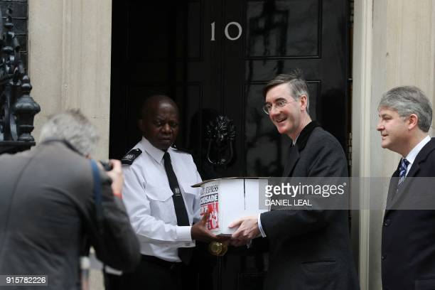 British conservative party member of parliament Jacob ReesMogg delivers a petition against the provision of foreign aid to 10 Downing Street in...
