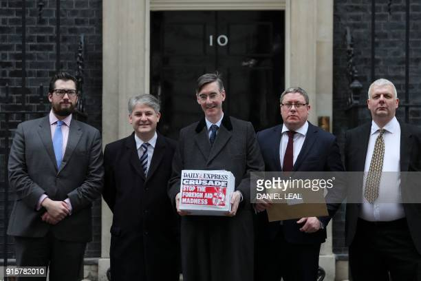 British conservative party member of parliament Jacob ReesMogg poses as he delivers a petition against the provision of foreign aid at 10 Downing...