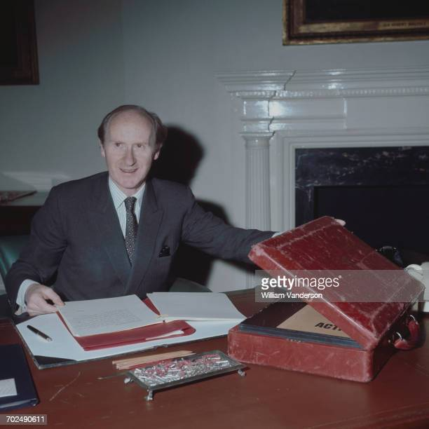 British Conservative Party politician and Chancellor of the Exchequer Anthony Barber places papers in Gladstone's battered red Budget Box as he makes...