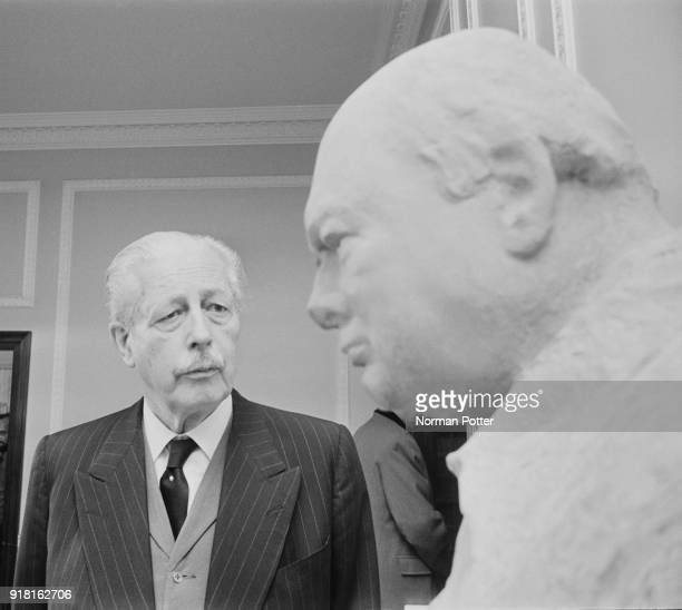 British Conservative Party politician and former Prime Minister of the United Kingdom Harold Macmillan near Winston Churchill bust unveiled at the...