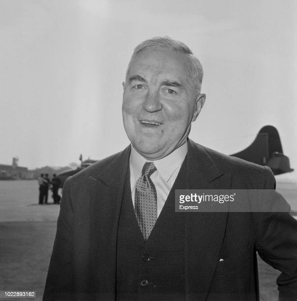British Conservative Party politician and Home Secretary, Henry Brooke pictured at an airfield in England on 13th June 1963.