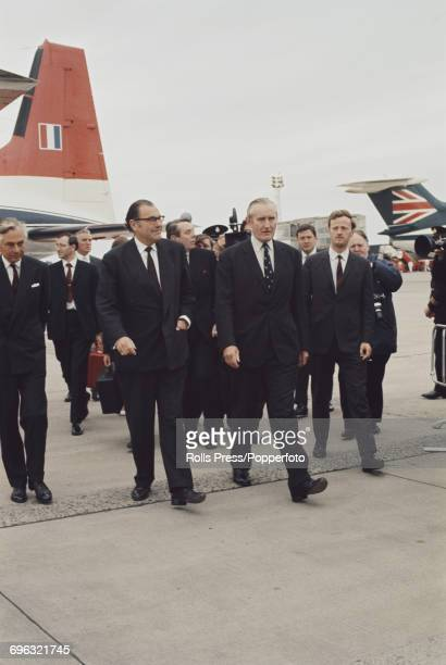 British Conservative party politician and Home Secretary, Reginald Maudling pictured 2nd left with Prime Minister of Northern Ireland, James...