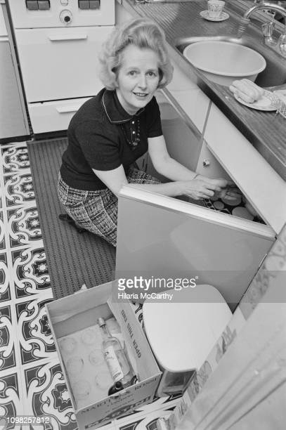 British Conservative Party politician and Leader of the Opposition Margaret Thatcher doing housework in her kitchen, UK, 3rd February 1975.