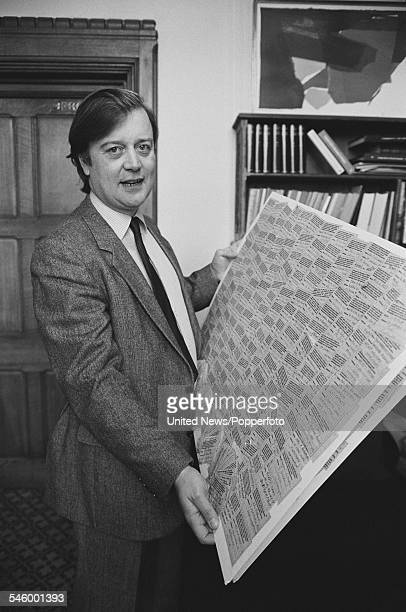 British Conservative Party politician and Member of Parliament for Rushcliffe in Nottinghamshire, Kenneth Clarke pictured holding up a board of text...