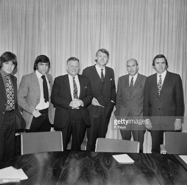 British Conservative party politician and Minister of Sport Eldon Griffiths pictured 4th from left as meets with football representatives from left...