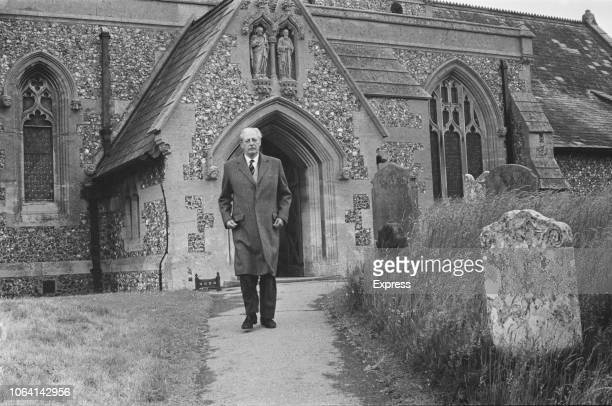 British Conservative Party politician and Prime Minister of the United Kingdom Harold Macmillan pictured walking away from the Church of St Peter St...