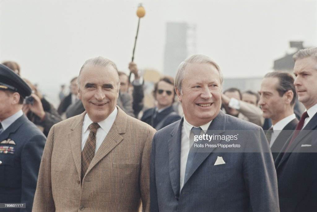 British Conservative Party politician and Prime Minister of the United Kingdom, Edward Heath (1916-2005) (on right) welcomes President of France Georges Pompidou (1911-1974) to the United Kingdom for talks after the arrival of the French premier at Northolt airport in West London on 18th March 1972.