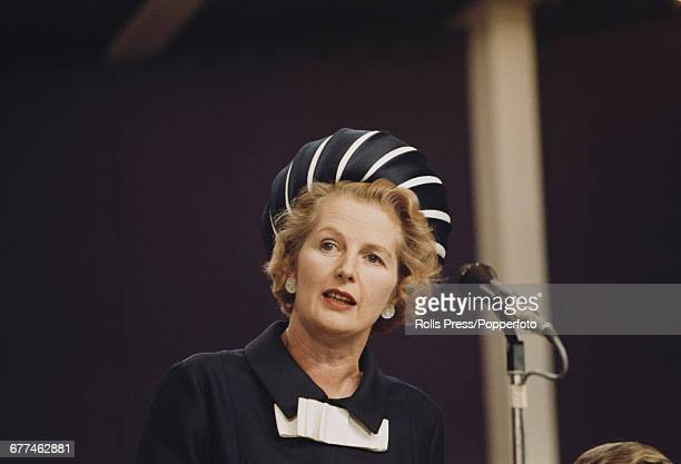 British Conservative Party politician and Secretary of State for Education and Science, Margaret Thatcher delivers a speech from the platform at the...