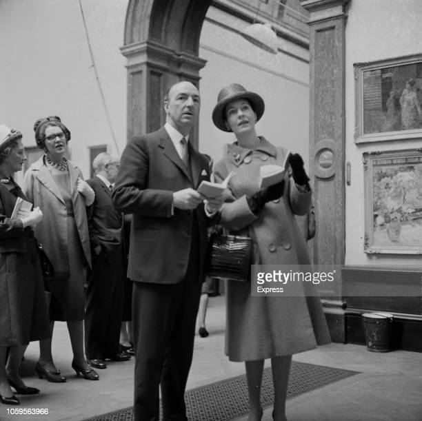 British Conservative Party politician and Secretary of State for War John Profumo pictured with his wife actress Valerie Hobson as the attend an...
