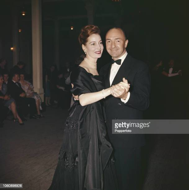 British Conservative Party politician and Secretary of State for War John Profumo pictured dancing with his wife Valerie Hobson at a civic reception...