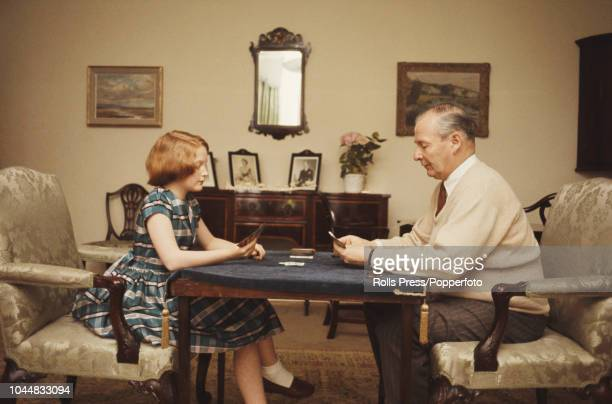 British Conservative Party politician and Speaker of the House of Commons Selwyn Lloyd pictured playing cards with his daughter Joanna circa 1971