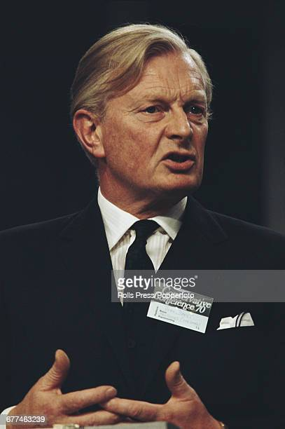 British Conservative Party politician businessman and President of the Board of Trade John Davies delivers a speech from the platform at the...