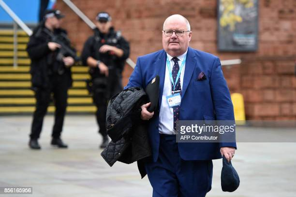 British Conservative Party politician Eric Pickles arrives at the Manchester Central convention centre in Manchester on October 1 the first day of...
