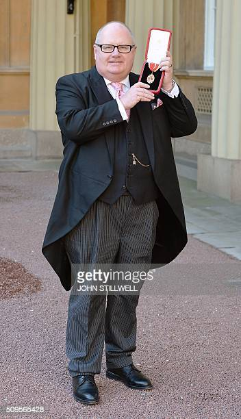 British Conservative Party politician Eric Pickles poses with his medal after being made a Knight Bachelor at an investiture ceremony at Buckingham...