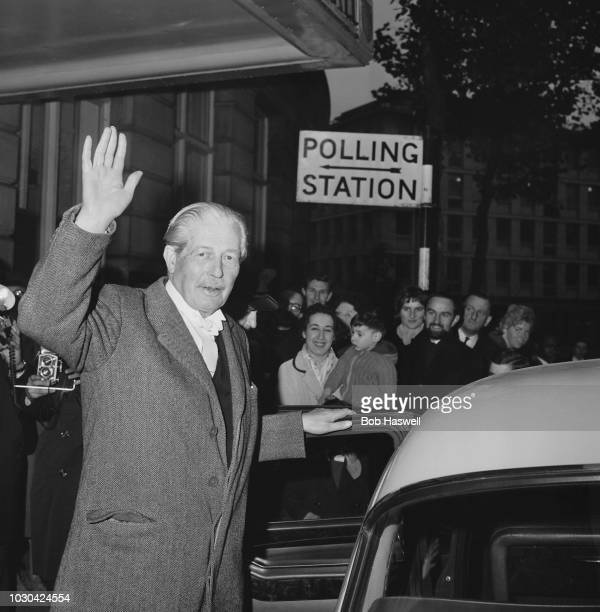 British Conservative Party politician Harold Macmillan waves while leaving Westminster City Hall after making vote at the 1964 General Election...