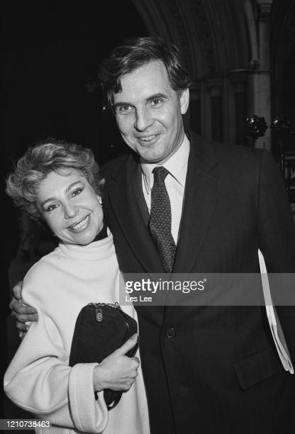 British Conservative Party politician Jonathan Aitken hugs his wife, Lolicia Aitken, after winning his libel case at the High Court in London,...