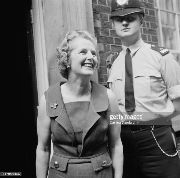 British Conservative Party politician Margaret Thatcher the new Secretary of State for Education and Science next to a policeman outside the Prime...