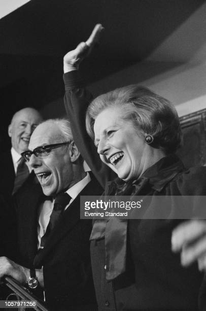 British Conservative Party politician Margaret Thatcher with her husband Denis waves to celebrate her victory in the 1979 General election to become...