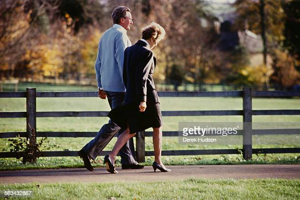 British Conservative Party politician Michael Heseltine walking with his wife Anne at their country home in Thenford Northamptonshire during the...