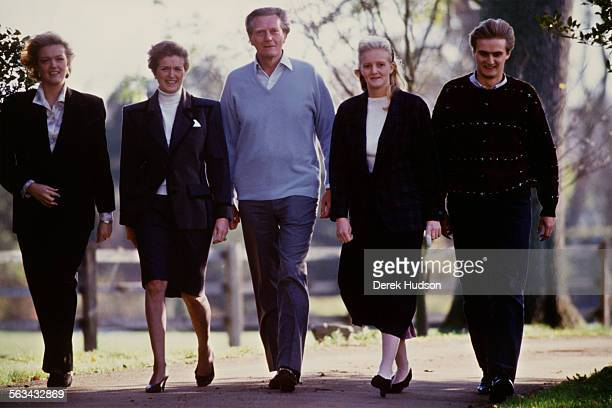 British Conservative Party politician Michael Heseltine walking with his wife Anne and children Rupert Alexandra and Annabel at their country home in...