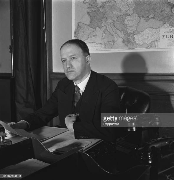 British Conservative Party politician Rab Butler , Under-Secretary of State for Foreign Affairs, seated at his desk at the Foreign and Commonwealth...