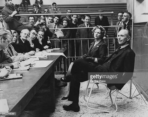 British Conservative politician Alec DouglasHome and his wife Elizabeth answering questions from journalists at the Auction Market during Alec's...