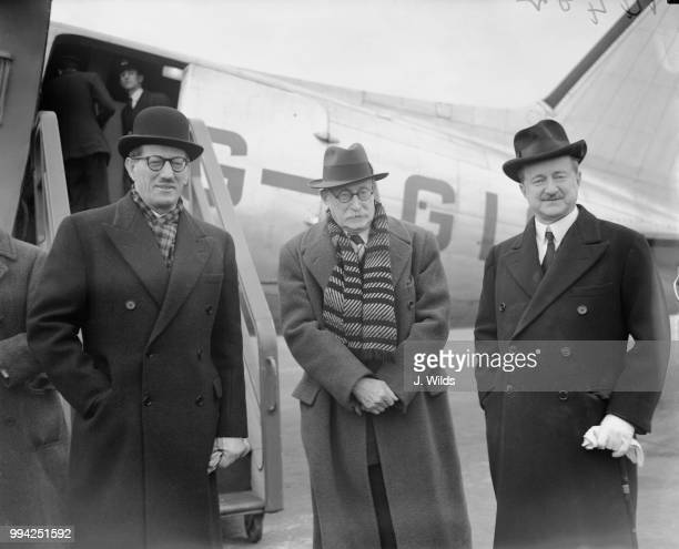 British Conservative politician Alfred Duff Cooper , the British Ambassador to France, with French Prime Minister Léon Blum and René Massigli , the...