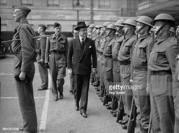 British Conservative politician Alfred Duff Cooper , the Minister of Information, inspects the Home Guard outside the Ministry of Information in...