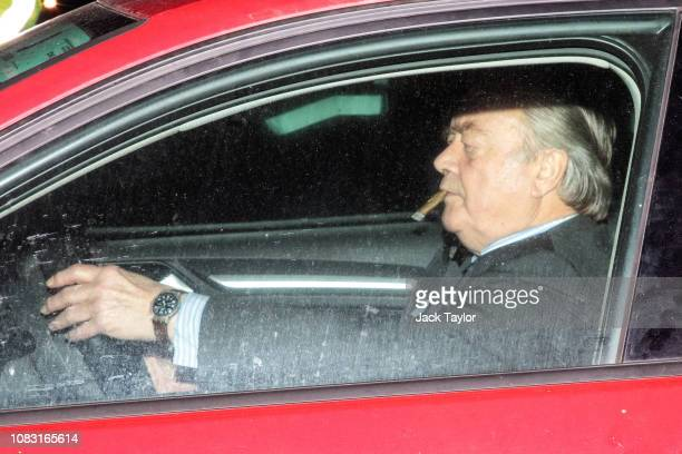 British Conservative politician and Father of the House of Commons Ken Clarke smokes a cigar as he leaves the House of Commons following the...
