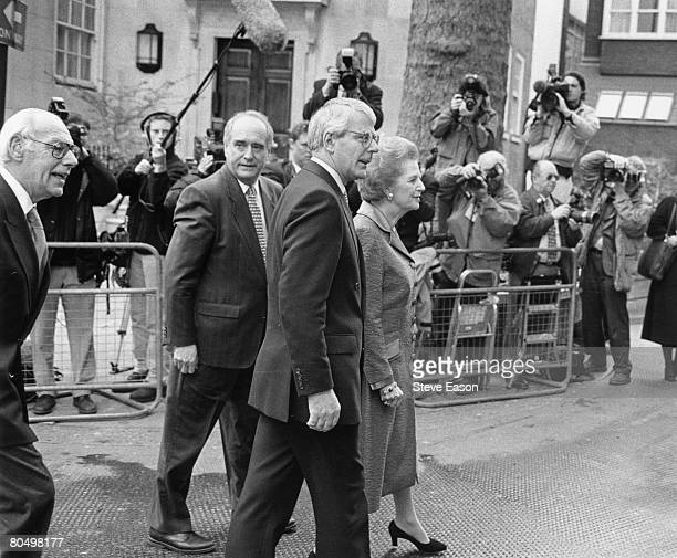 British Conservative politician and former prime minister, Baroness Thatcher with British prime minister, John Major outside their party's...