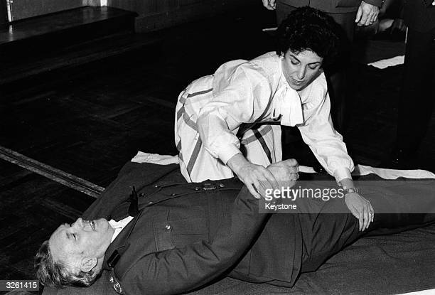 British Conservative politician and Junior Health Minister Edwina Currie attending a life saving class