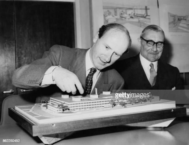 British Conservative politician Anthony Barber the Minister of Health presents a model of the new Greenwich Hospital at a press conference at the...