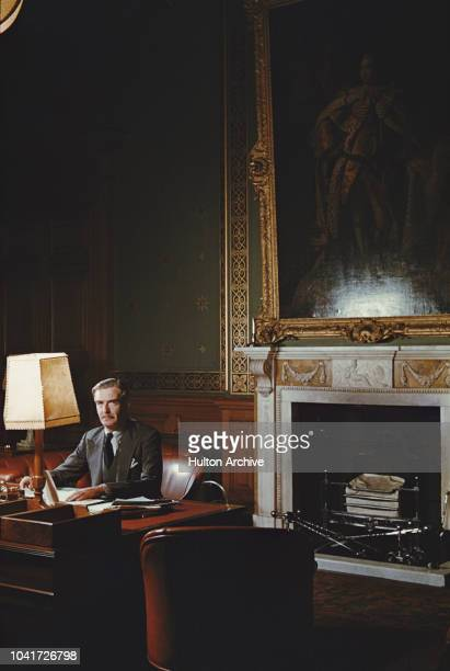 British Conservative politician Anthony Eden sitting at his desk under a large portrait of King George III circa 1950