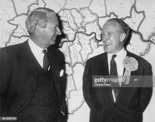 British Conservative politician Edward Heath , Leader of the Opposition, and Desmond Plummer , leader of the GLC , with a map of the GLC...