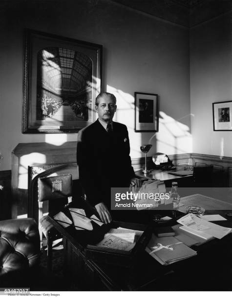 British conservative politician Hon Harold MacMillan stands behind a desk in an office in the House of Commons London England March 1 1954