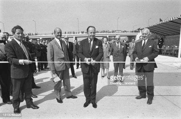 British Conservative politician John Peyton , the Minister of Transport, officially opens the new section of the M40 motorway at the Gerrards Cross...
