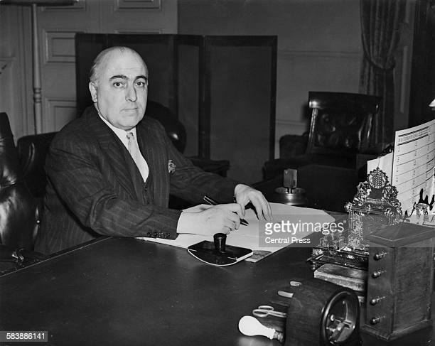 British Conservative politician lawyer and judge David Maxwell Fyfe in his office at the Home Office following his appointment as Home Secretary in...
