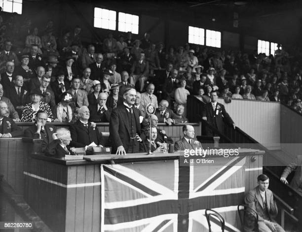 British Conservative politician Neville Chamberlain , the Chancellor of the Exchequer, addresses a mass Conservative demonstration in support of the...
