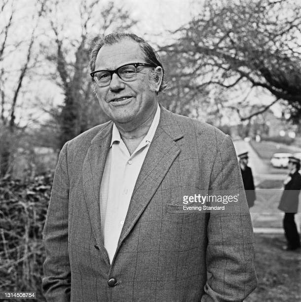 British Conservative politician Reginald Maudling , the former Home Secretary, UK, 5th February 1974. Behind him, the police are investigating a...