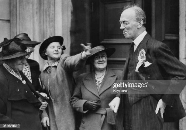 British Conservative politician Sir Donald Somervell , the Home Secretary and MP for Crewe, jokes with female supporters during his election campaign...