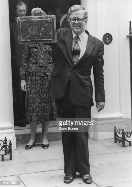 British Conservative politician Sir Geoffrey Howe the Chancellor of the Exchequer leaves 11 Downing Street in London with the Budget box to present...