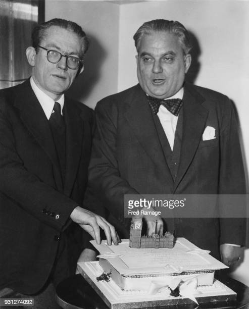 British Conservative politician Sir Robert Boothby later Baron Boothby KBE celebrates his birthday with Labour politician Michael Foot during the...