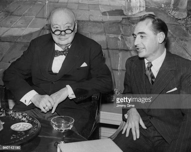 British Conservative politician Winston Churchill after presenting Australian writer and journalist Alan Moorehead with the first Duff Cooper...