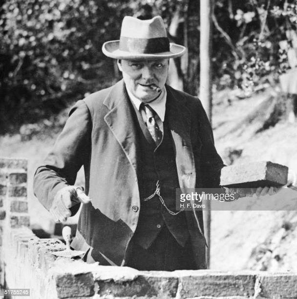 British Conservative politician Winston Churchill building a wall at his home in Chartwell Kent September 1928