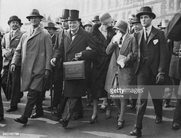 British Conservative politician Winston Churchill Chancellor of the Exchequer makes his way to the House of Commons in London to present his budget...