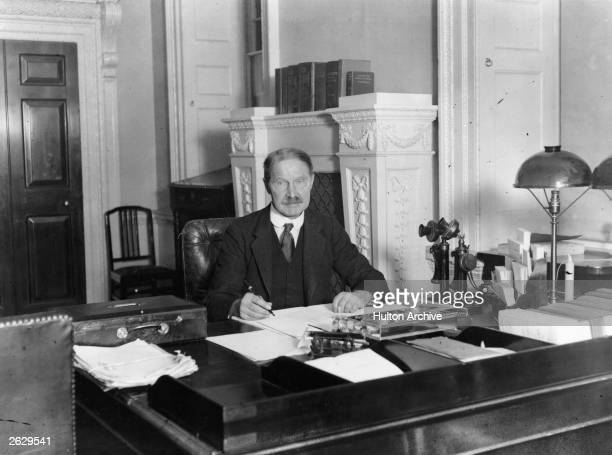 British Conservative prime minister Andrew Bonar Law at his desk at No 10 Downing Street Bonar Law born in Canada moved to Scotland as a young boy He...