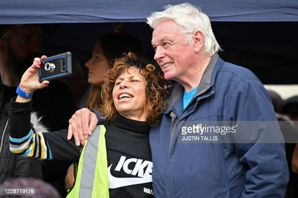 British 'conspiracy theorist' David Icke poses for a selfie photograph with a fan in Trafalgar Square in London on September 26 at a 'We Do Not...