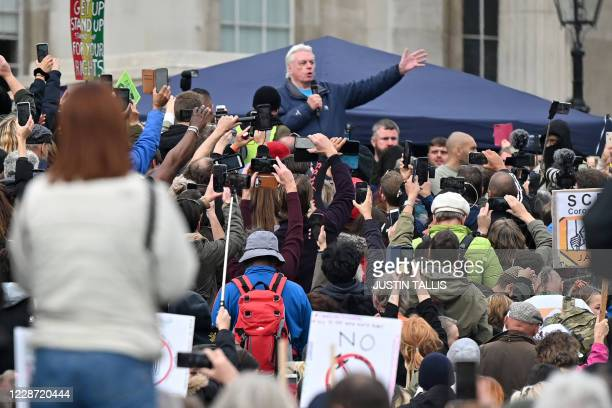 British 'conspiracy theorist' David Icke, speaks at a gathering of protesters in Trafalgar Square in London on September 26 at a 'We Do Not Consent!'...