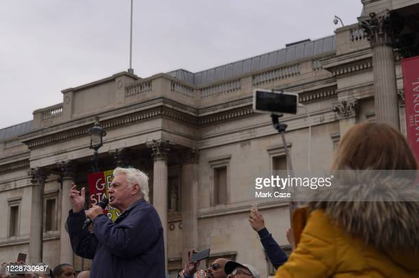 British conspiracy theorist, David Icke speaks during the anti-mask protest at Trafalgar Square on September 26, 2020 in London, England. Thousands...
