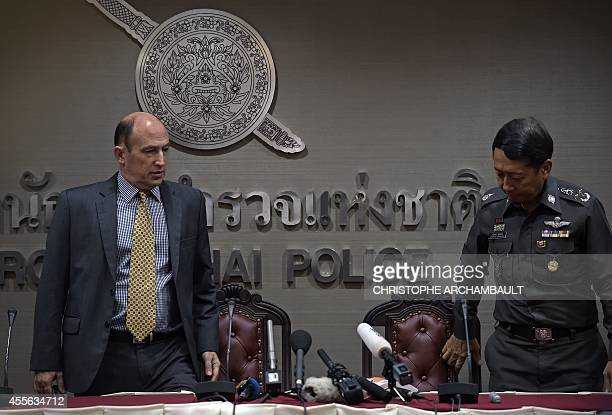 British Consul from the British embassy Michael Hancock and Police General Jarumporn Suramanee arrive for a press conference on the murder case of...